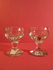 Pair of firing glasses, English, 19th century; rare design with round bowls, narrow stems and round bases.