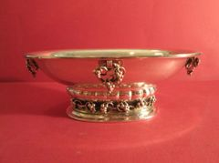 Sterling silver bowl, centerpiece with grape decoration, American, ca. 1900. The decoration is cast and applied. The base has clusters of grapes that were cast and four grape cluster swinging handles.