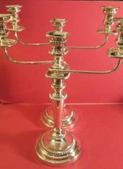 Pair of large, Old Sheffield candelabra with removable arms and removable bobeches on gadrooned, round bases, ca. 1790, England.