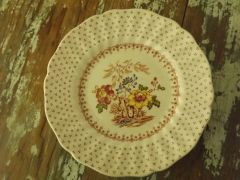 "English ""Grantham"" four bread & butter plates"