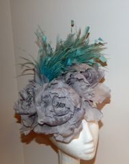 Grey Pillbox hat, covered with 3 Large silk flowers and Turquoise and grey feathers