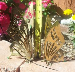Two (2) solid brass butterfly sculptures