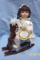 "COLLECTIBLE DOLL: Collectors Porcelain 14"" Doll on Brown Wood Rocking Horse by Crowne"