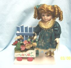 "COLLECTIBLE DOLLS: Collectible Porcelain 9.5"" Doll on Wooden Base with Wagon by Collector's Choice"