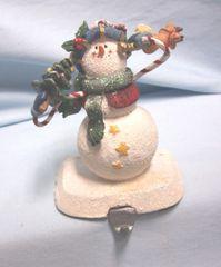 STOCKING HOLDER: Vintage Stocking Hanger Christmas Snowman on Cast Iron Base