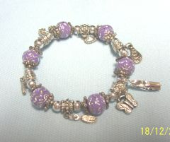 JEWELRY: Stretch Bracelet with Purple & Silver Beads with Various Dangling Charms by Joycelyn Collection