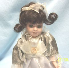"DOLLS: Collectible Doll 8 1/2"" Porcelain Doll with Black Hair Gorgeous Green Eyes"