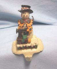 STOCKING HOLDER: Vintage Cast Iron Stocking Holder/Stocking Hanger Christmas Snowman with Sewing Machine