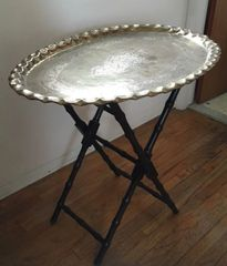 gorgeous antique substantial removable brass tray on table