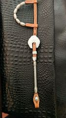 Show headstall with swirl design on buckle