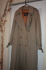 BURBERRYS RAINCOAT. 50 inches long and 21 inches across shoulders. FOR MAN OR WOMAN