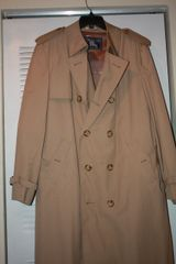 BURBERRYS RAINCOAT. 47 inches long and 21 inches across shoulders. FOR MAN OR WOMAN