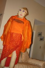 SAUSHA wears the orange-tailored alteraltions requested by the client.
