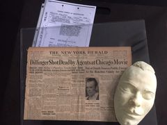 JOHN DILLINGER DEATH MASK, ORIGINAL NEWSPAPER WITH FRONT PAGE HEADLINE OF HIS DEATH, AND COPIES OF FBI REPORTS
