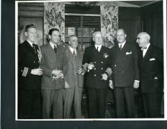 ADMIRAL CHESTER W. NIMITZ SIGNED 10 X 8 GROUP PHOTO WITH TONY HULMAN OWNER OF INDPS 500