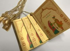 Wedding Program Booklet Indian Bride and Groom in Gold paper, decorated with a tassel